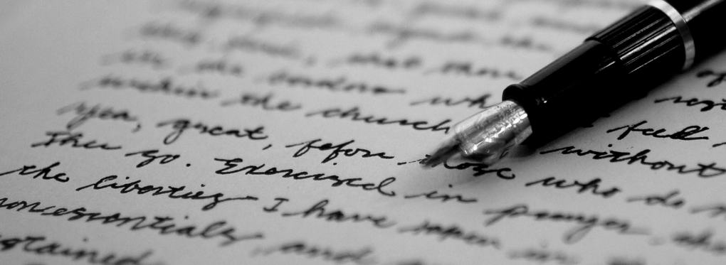 image of pen with handwritten letter