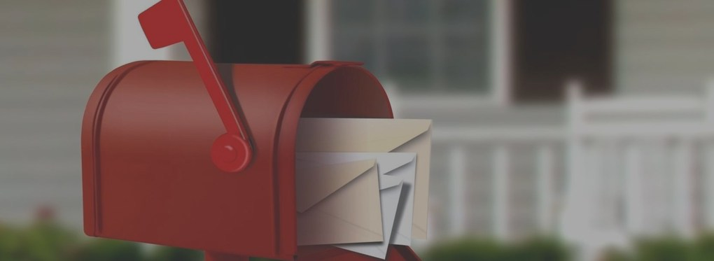 image of red mailbox with letters inside ready to mail